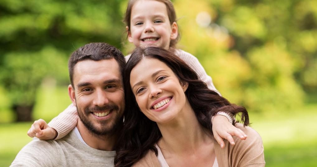Smiling family outside