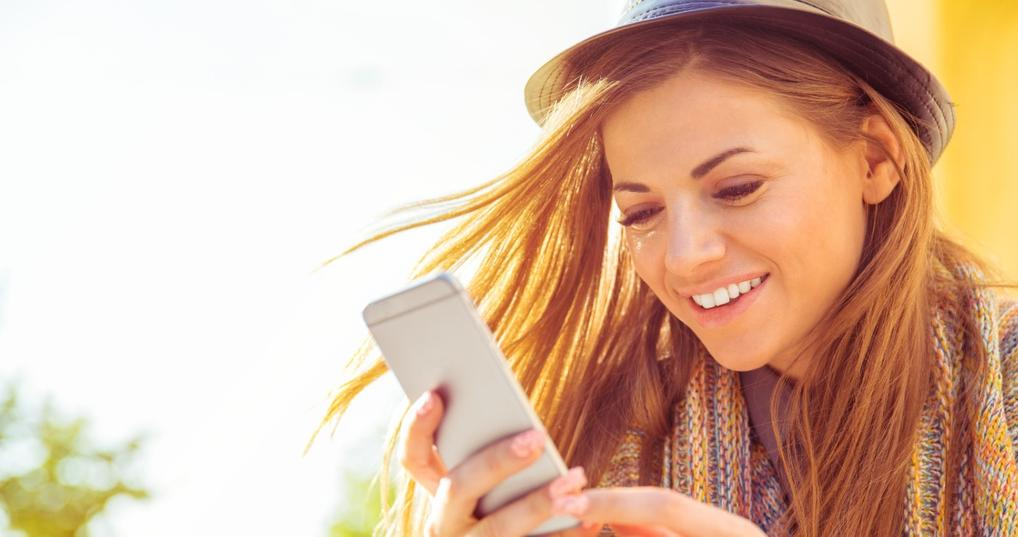 woman in sun on phone