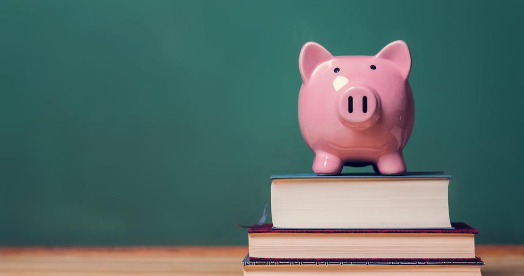 Piggy bank sitting on books