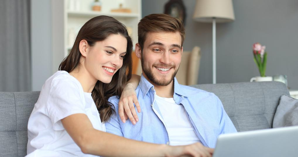 Smiling couple using computer