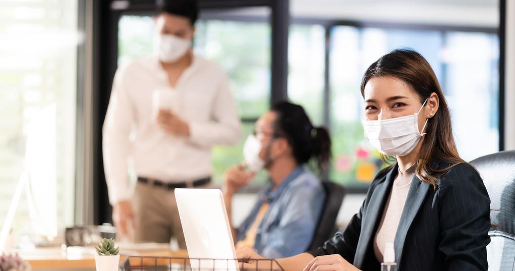 Woman wearing mask in office