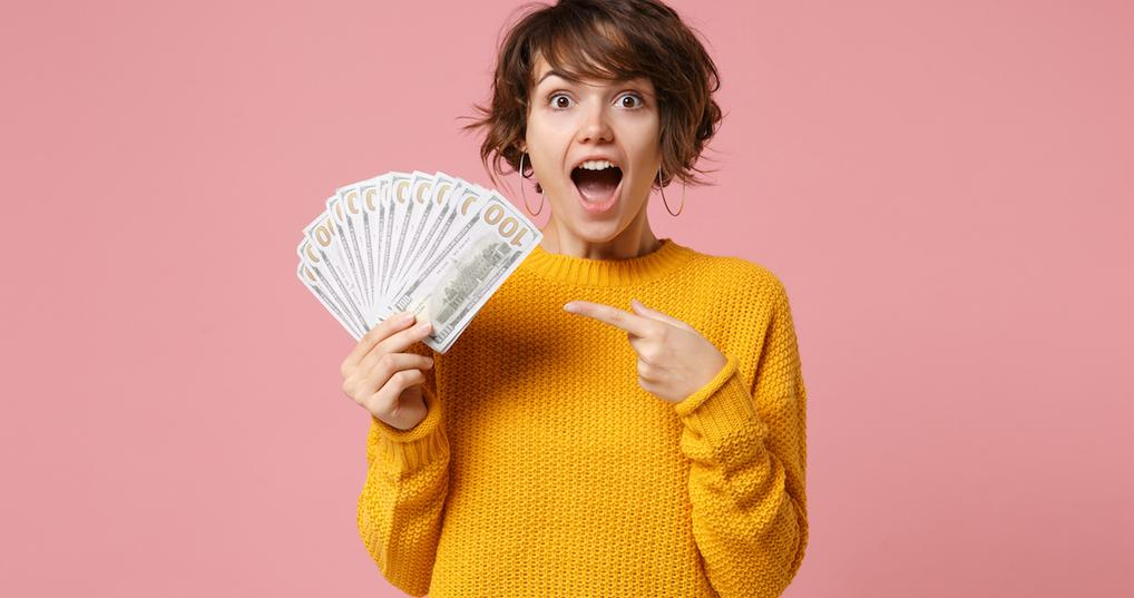 Woman holding lots of money