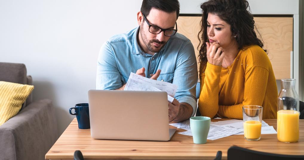 Couple at table looking at finances