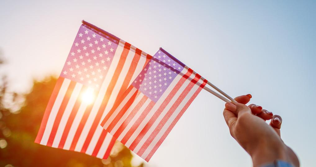 Woman holding American flags