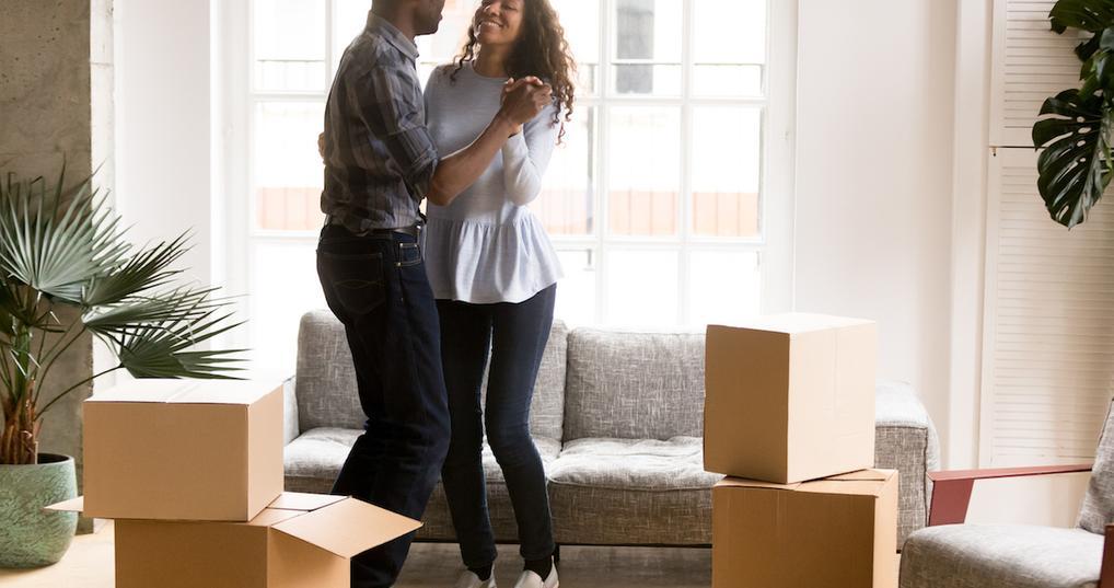 Couple dancing in new living room