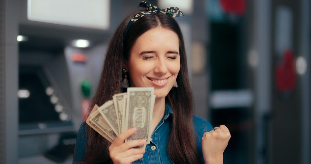 Excited woman holding money