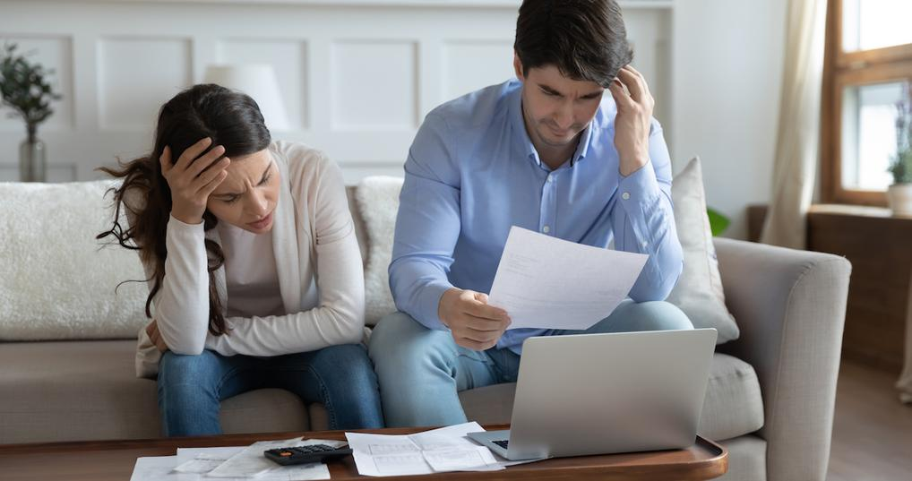 Worried couple reviewing finances