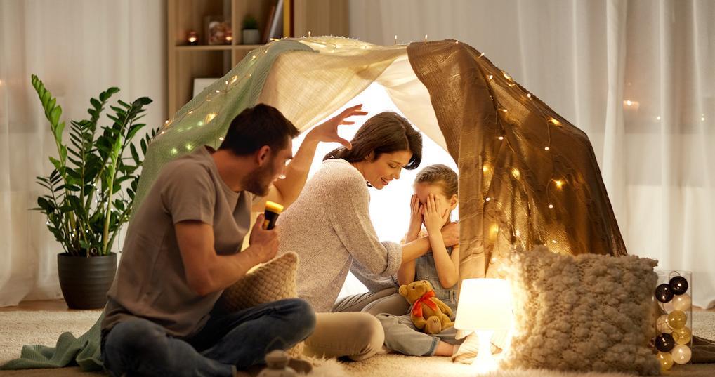 Family in blanket fort