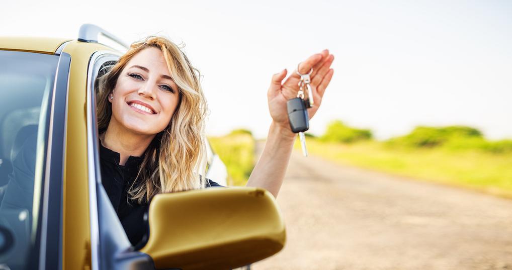 Woman in car holding keys