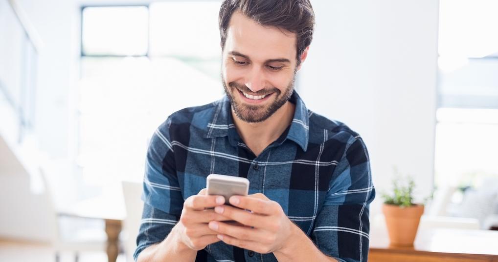Happy man using phone