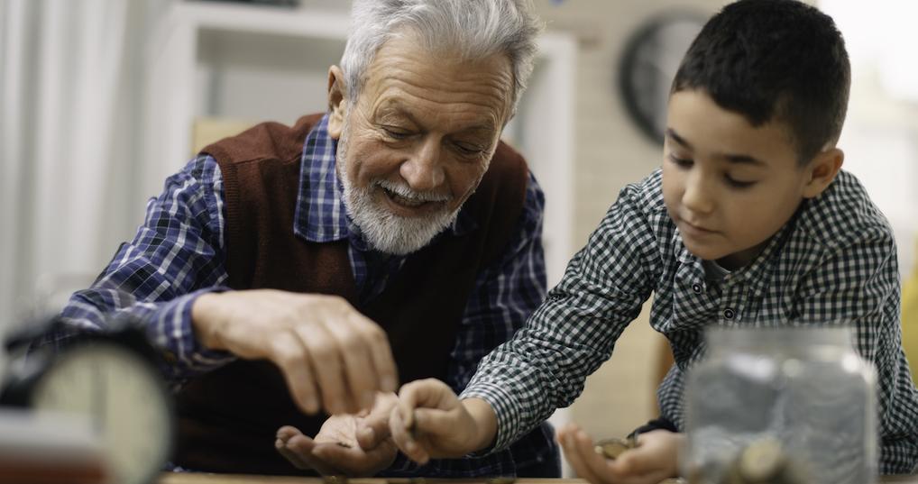 Grandfather and grandson saving money