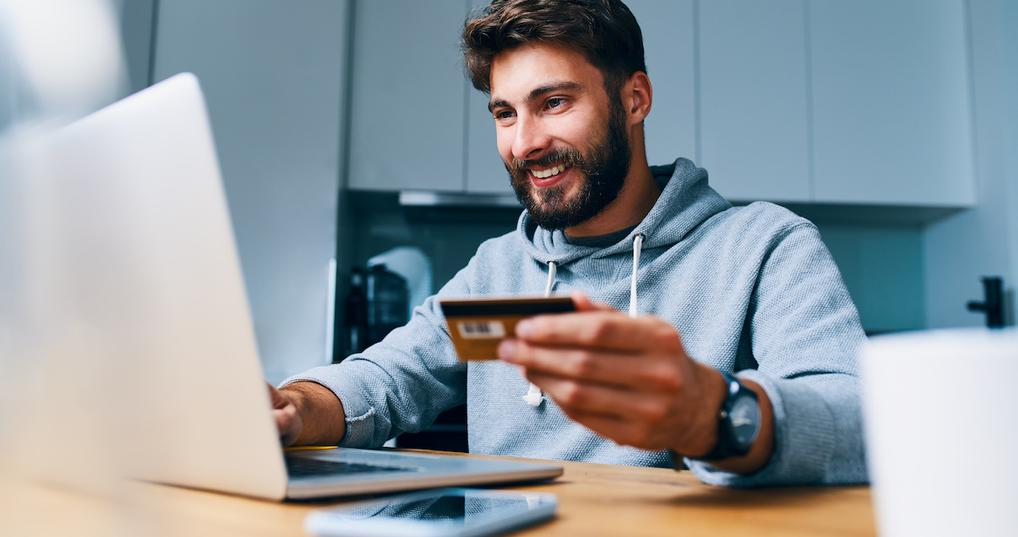 Happy man shopping online