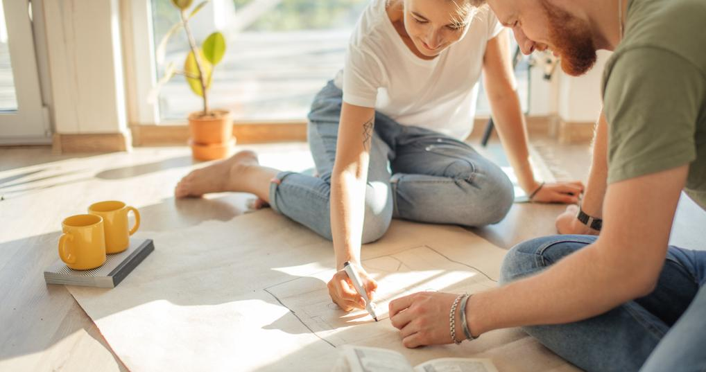 Couple working on house plans