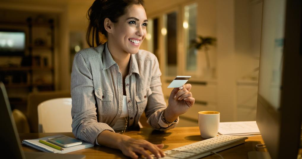 Smiling woman using credit card