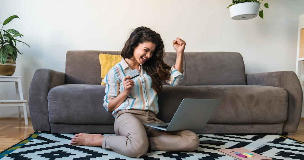Excited woman with credit card