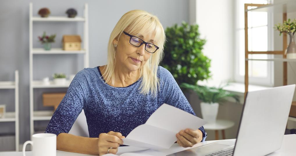 Concerned woman reviewing bills