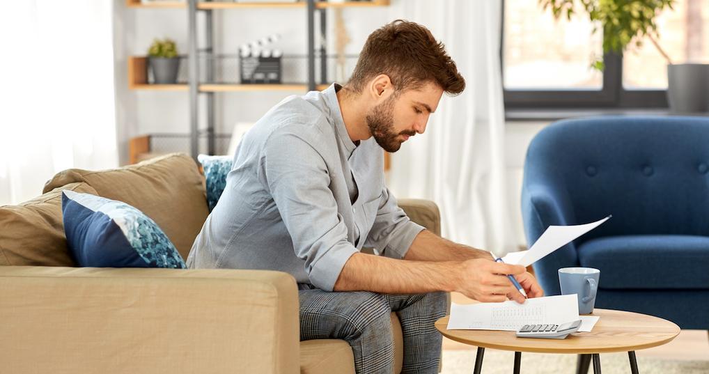 Worried man reviewing budget