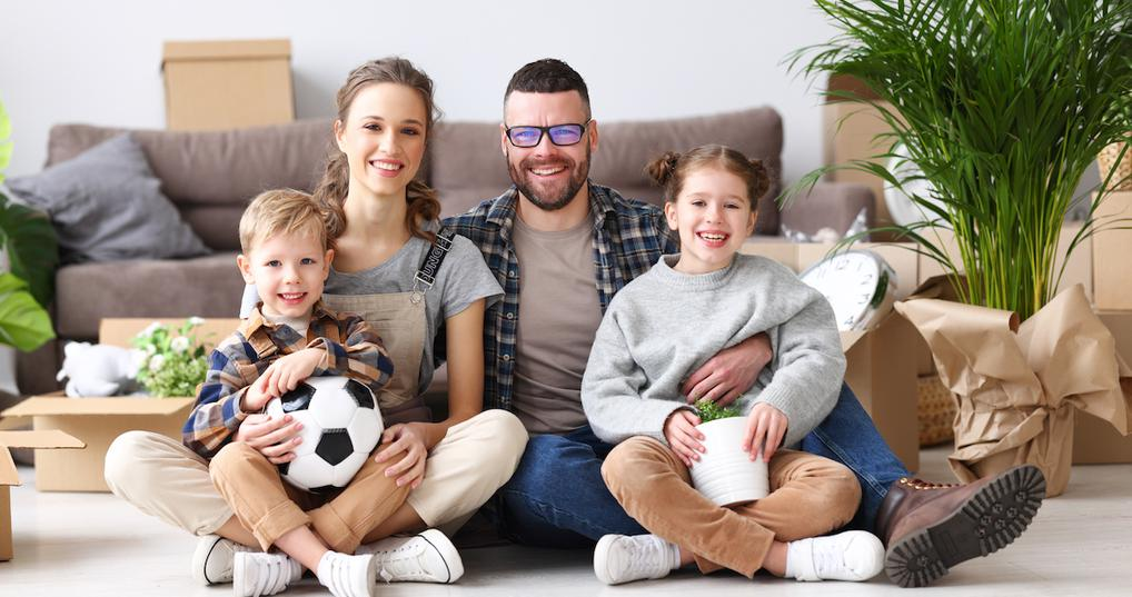 Smiling family in new home