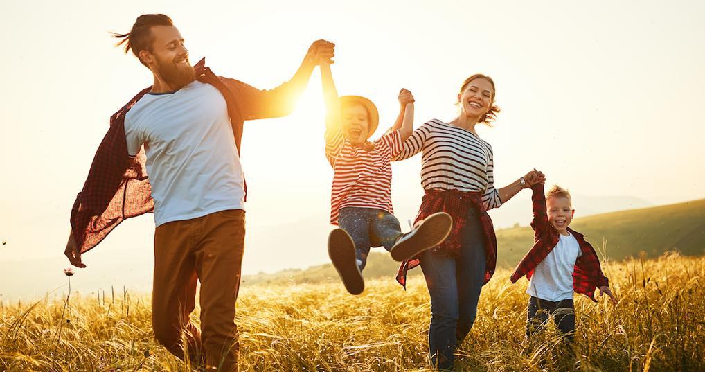 Happy family enjoying sunset