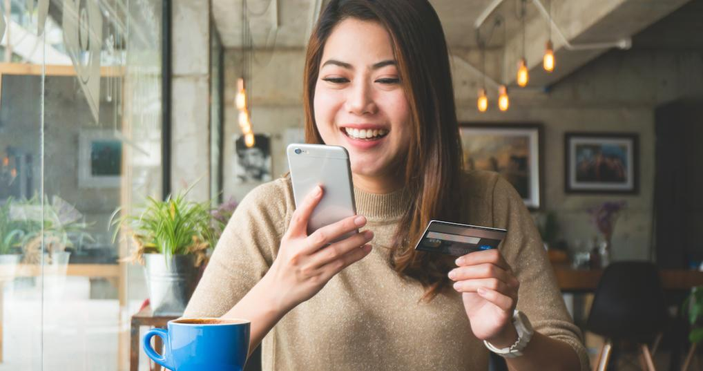 Smiling woman browsing Chase Offers