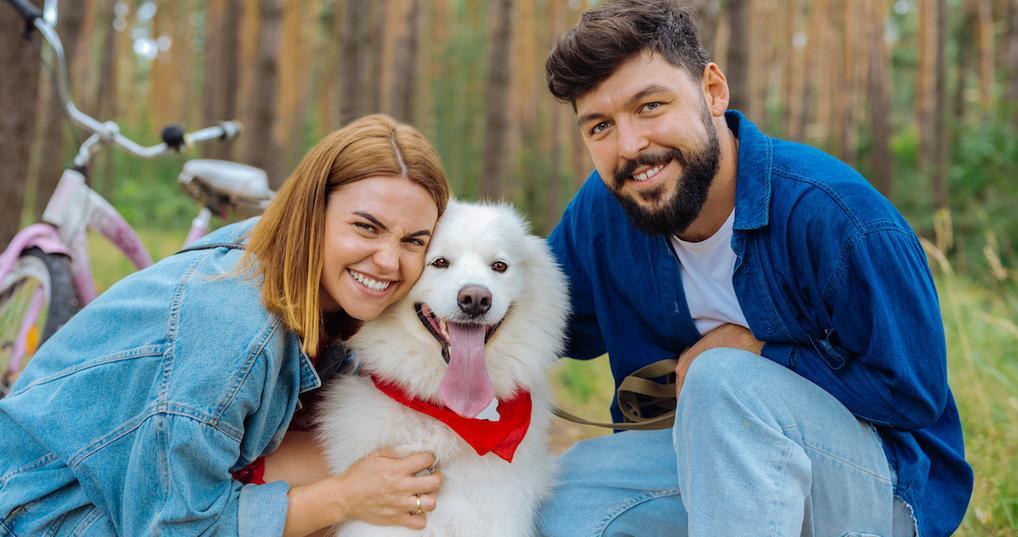 Happy couple with dog