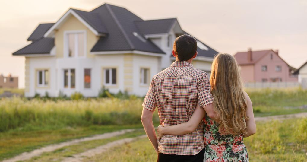 First-time homebuyers looking at house