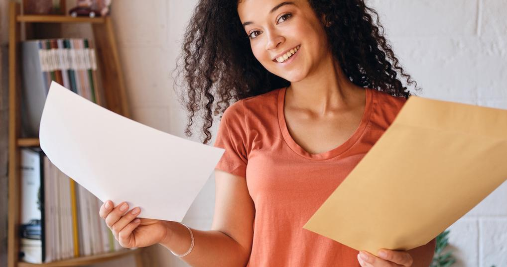Teen with college acceptance letter