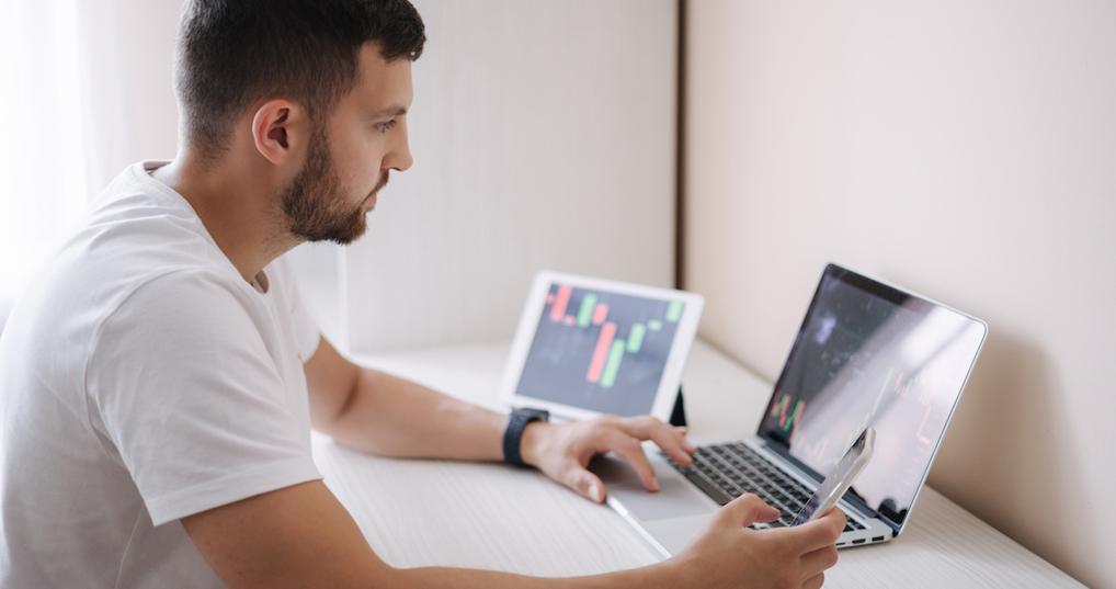 Man tracking crypto prices