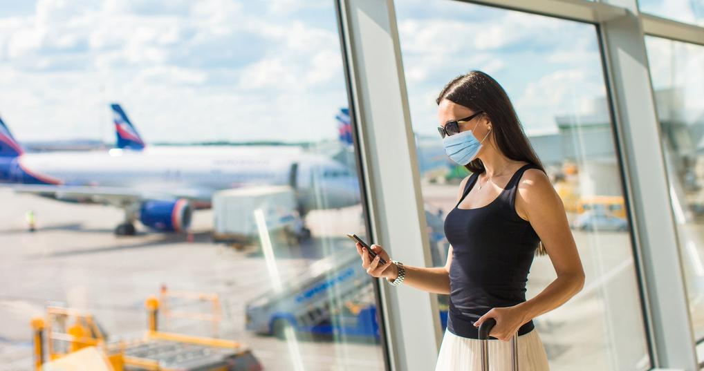 Traveler in airport wearing face mask