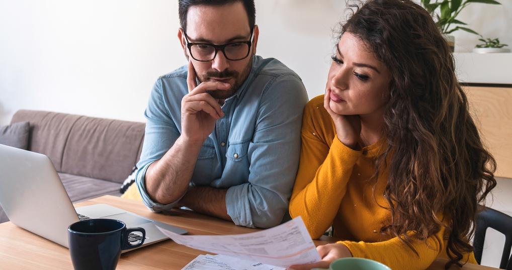 Couple looking at financials