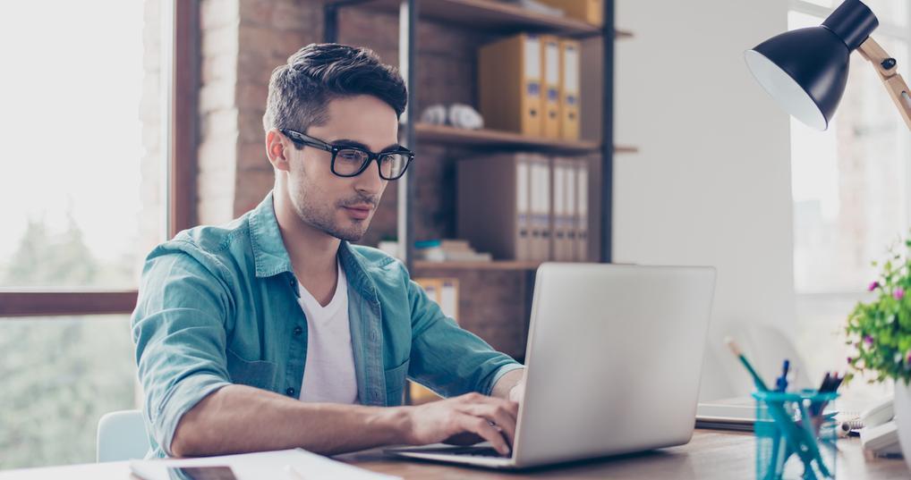 Man calculating debt-to-income ratio