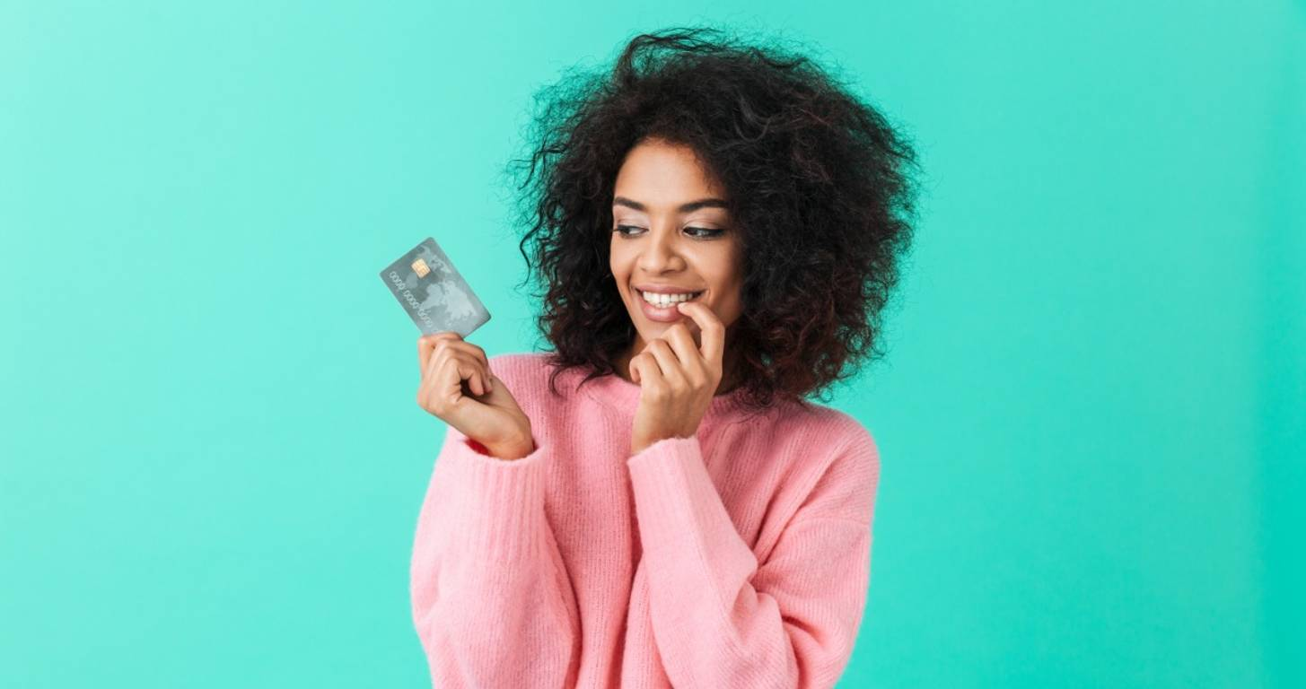 Woman holding a credit card and smiling