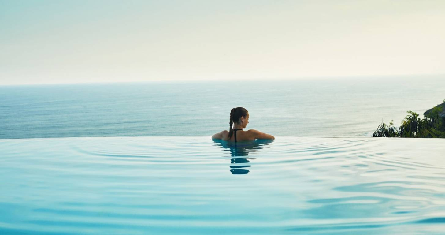 Woman enjoying the pool at a luxury resort