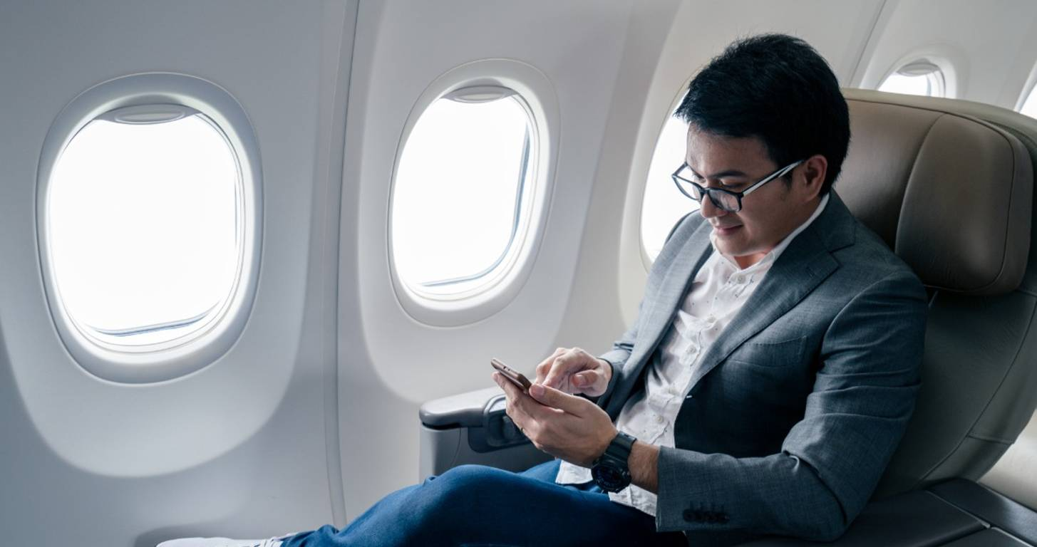 Young businessman sitting in a business class seat