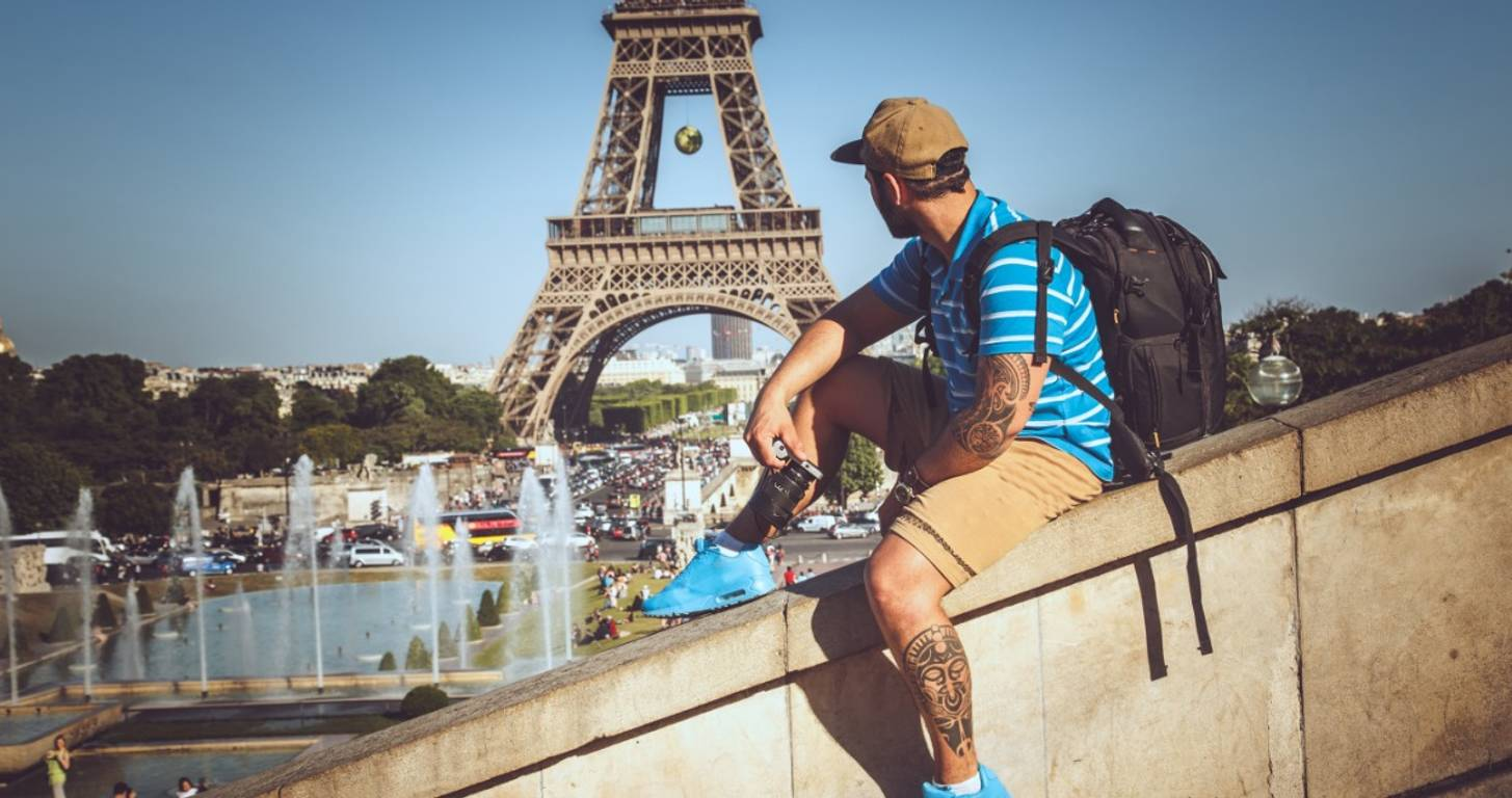 Man sitting in front of Eiffel Tower