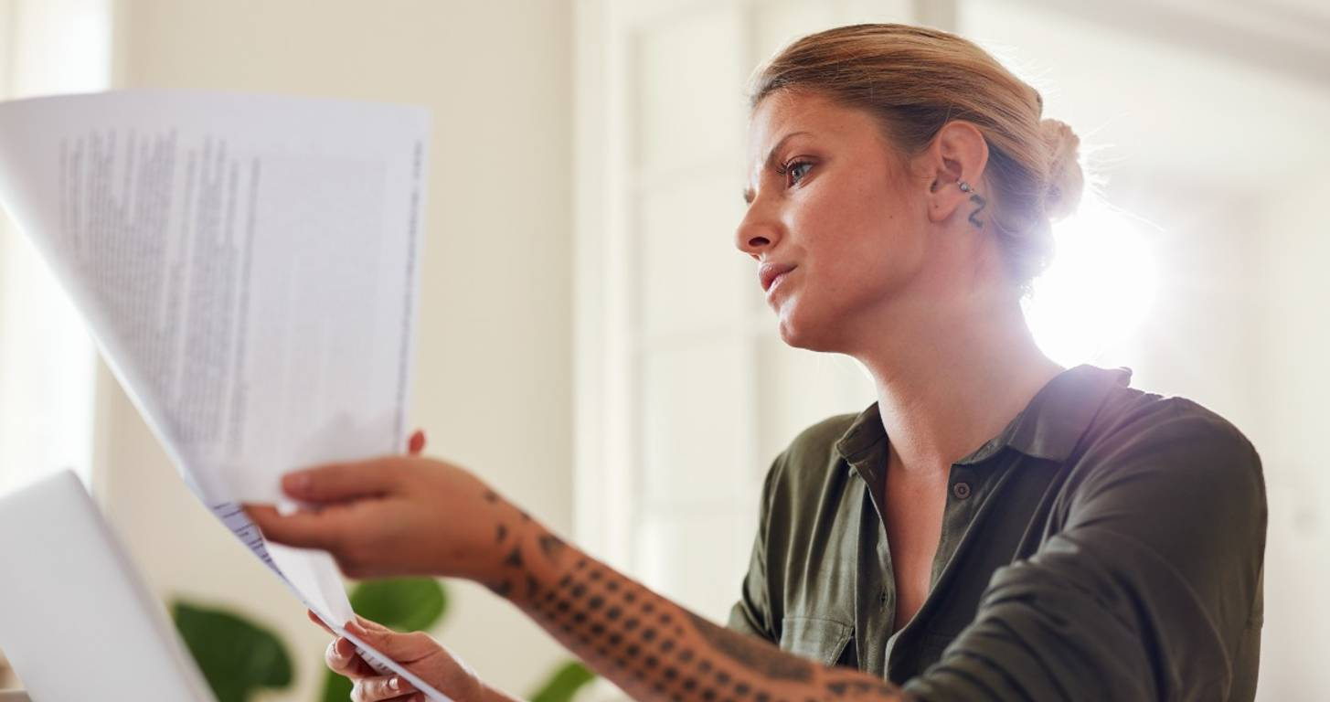 Woman going through financial statements at home