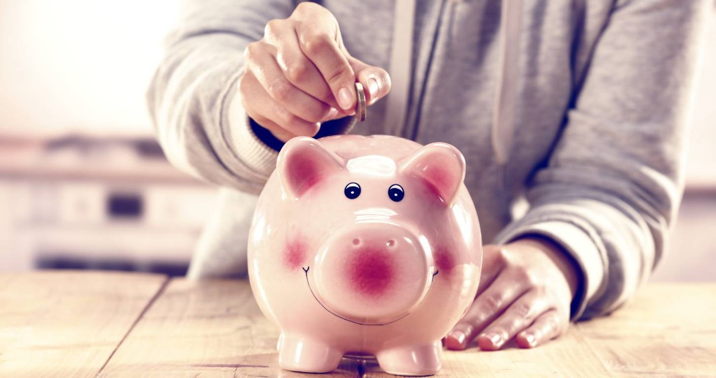 Woman saving money in a piggy bank