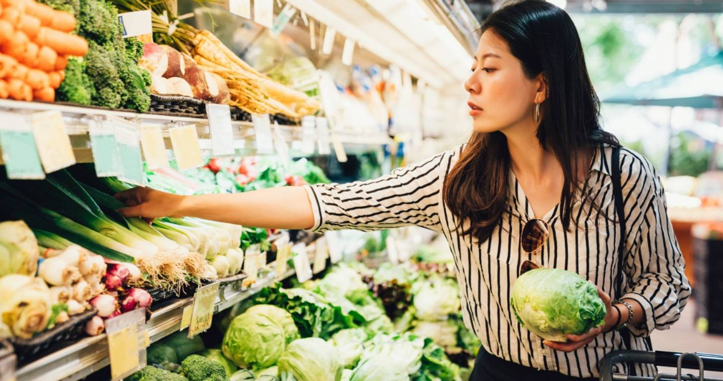 Woman shopping in the produce department at the grocery store