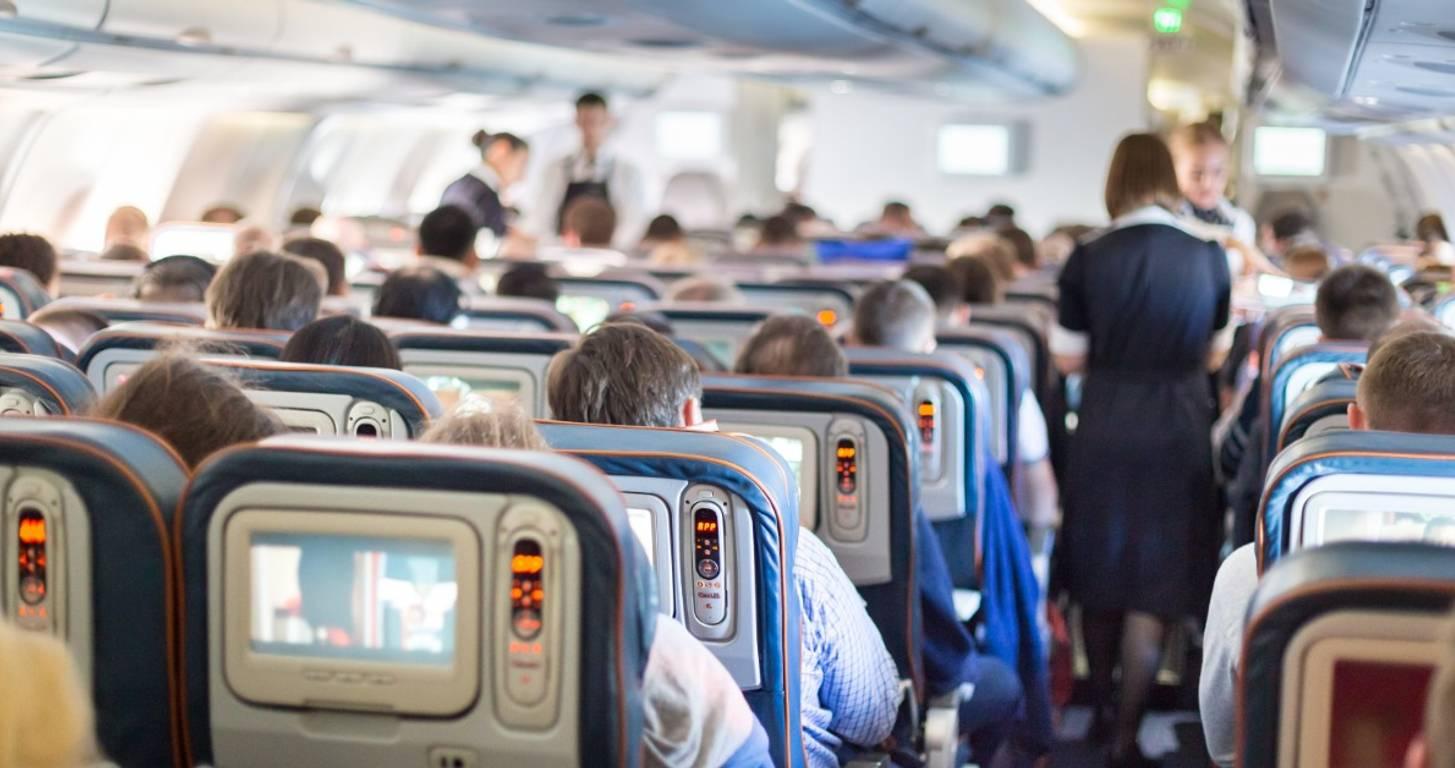 Flight attendants serving passengers on a plane