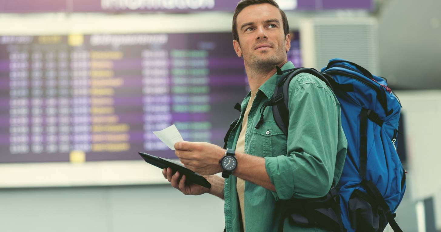 Man Checking Airfare Comparison at the Nation's Busiest Airports