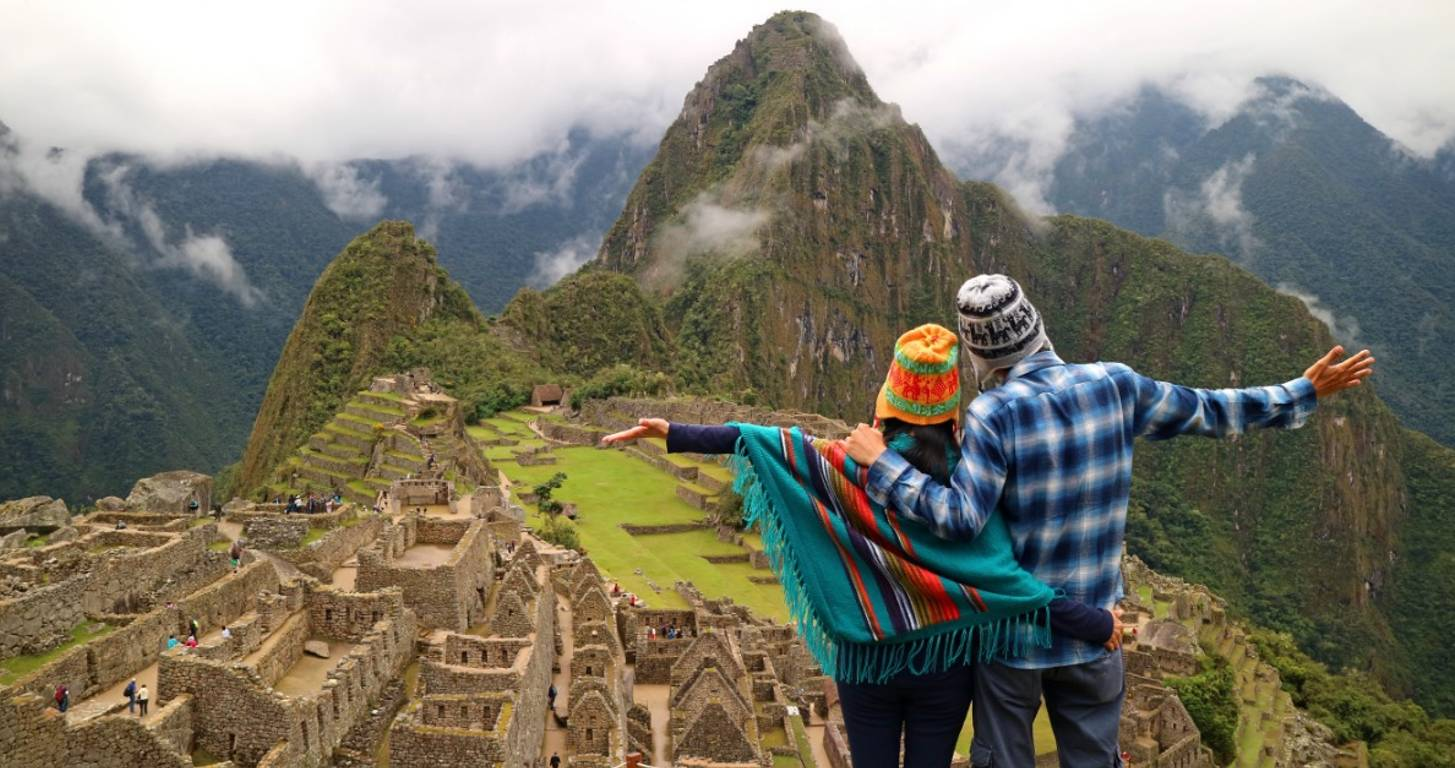 Couple overlooking Machu Picchu in Peru