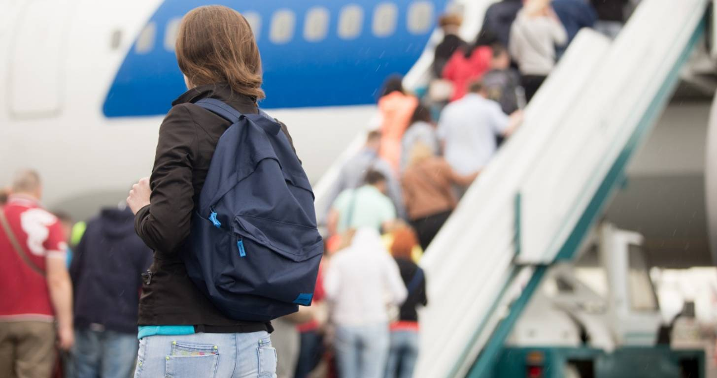 Young woman waiting to board an airplane