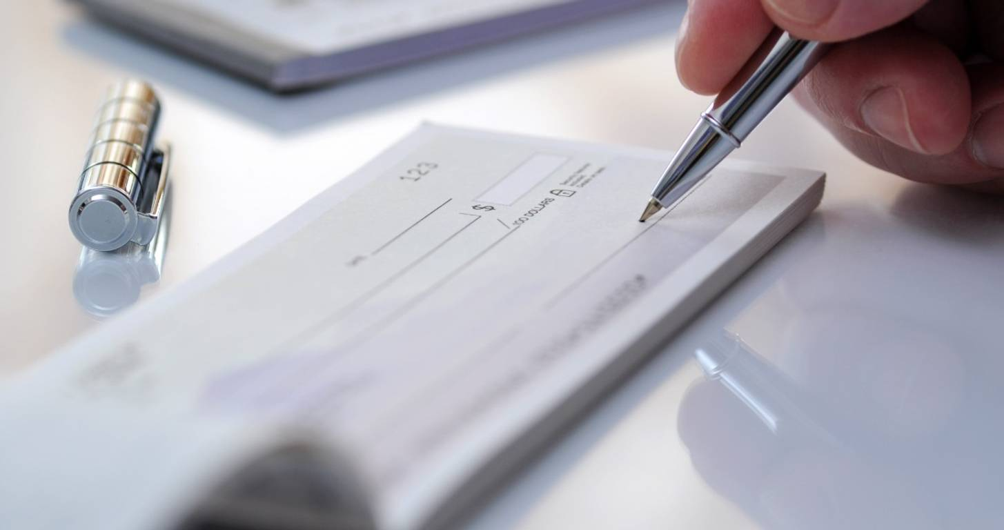 Writing out a check with a pen