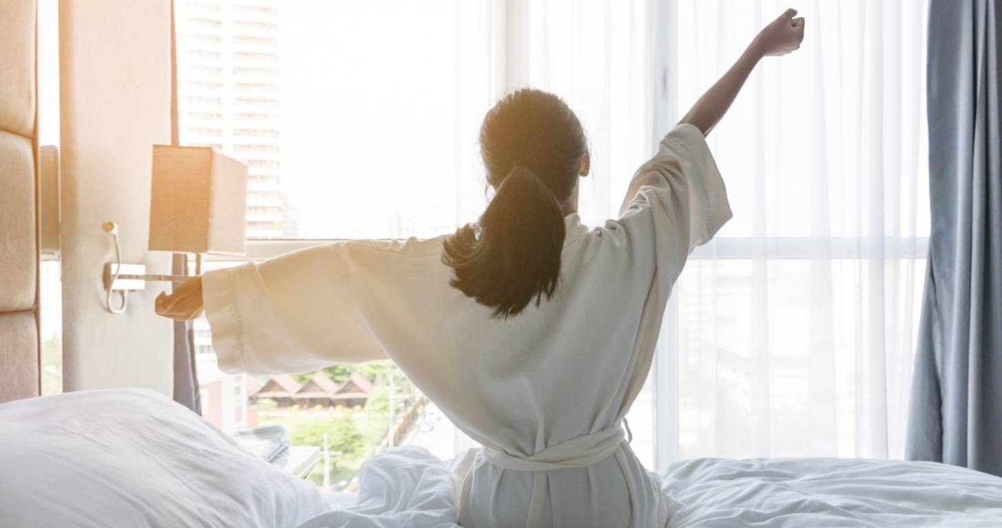 Woman in a bathrobe in a hotel room