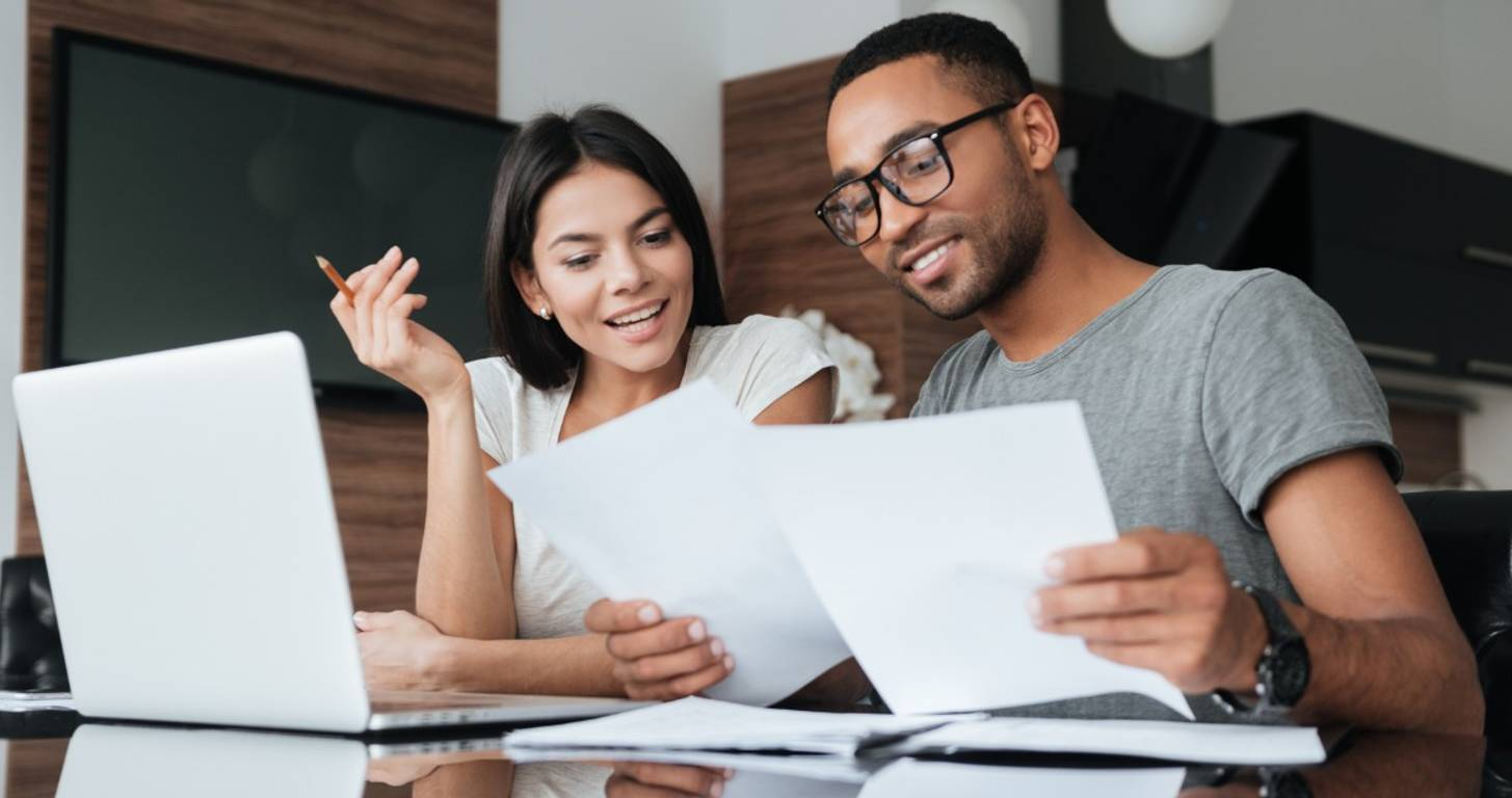 Couple looking over soft credit check