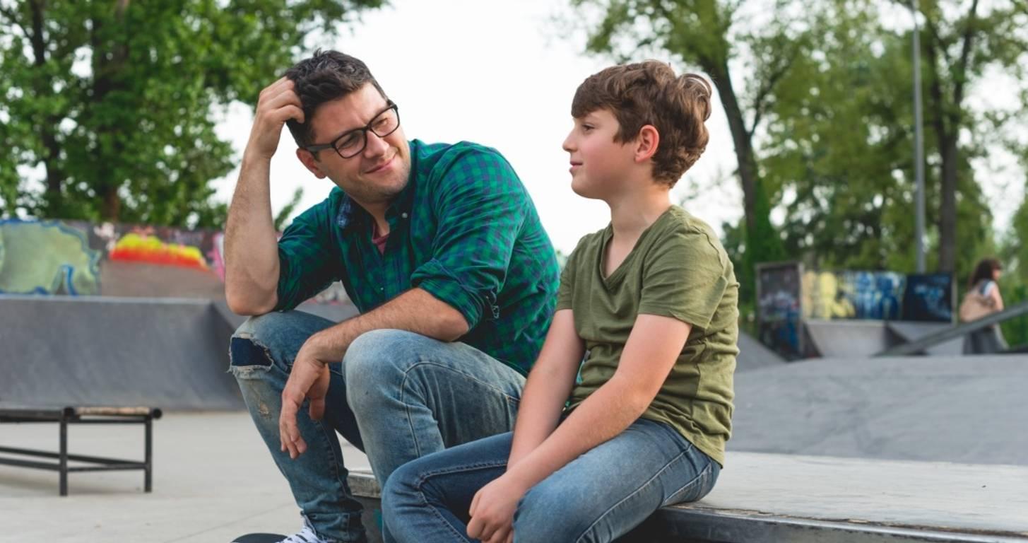 Dad talking to teenage son