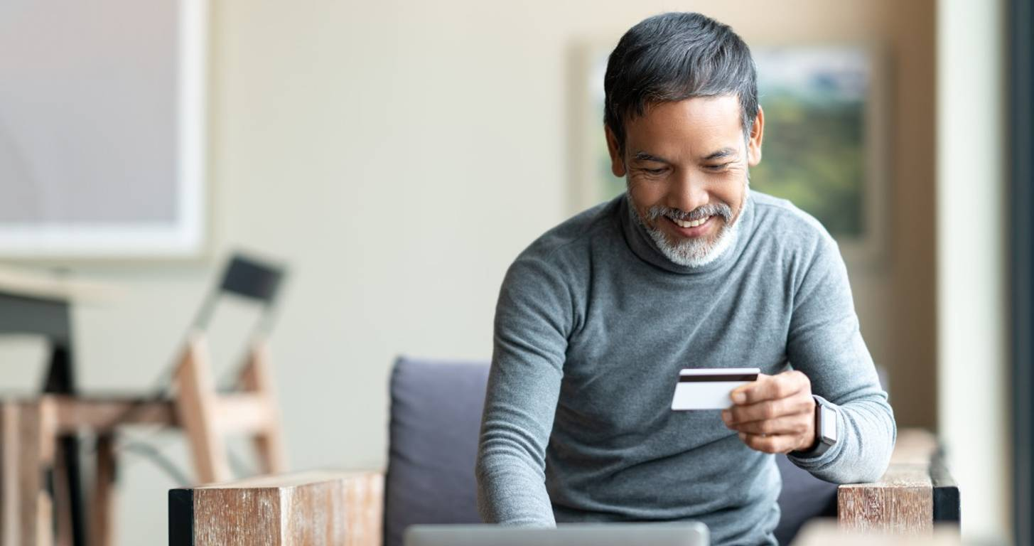 Man using unsecured credit card