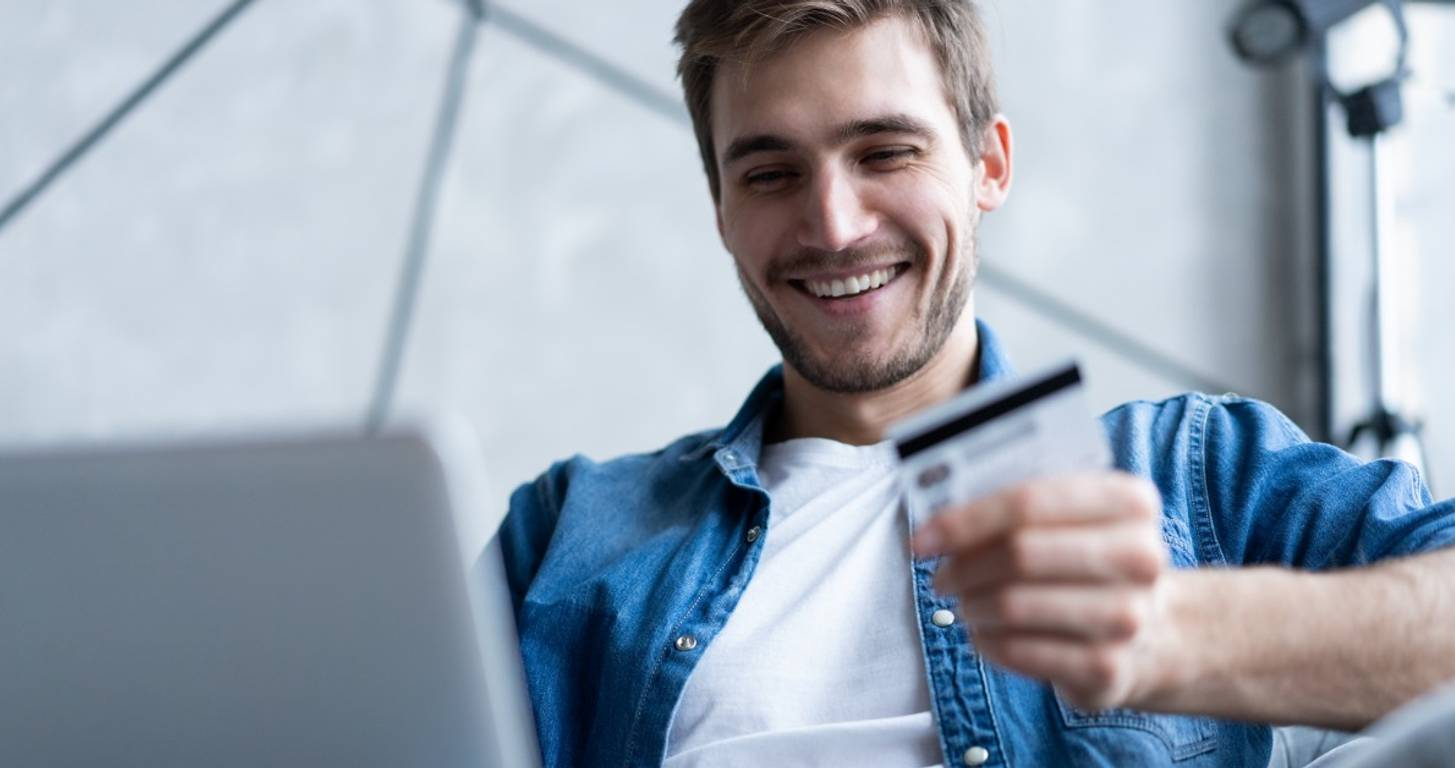 Man Holding Best Credit Card for Shopping on Amazon