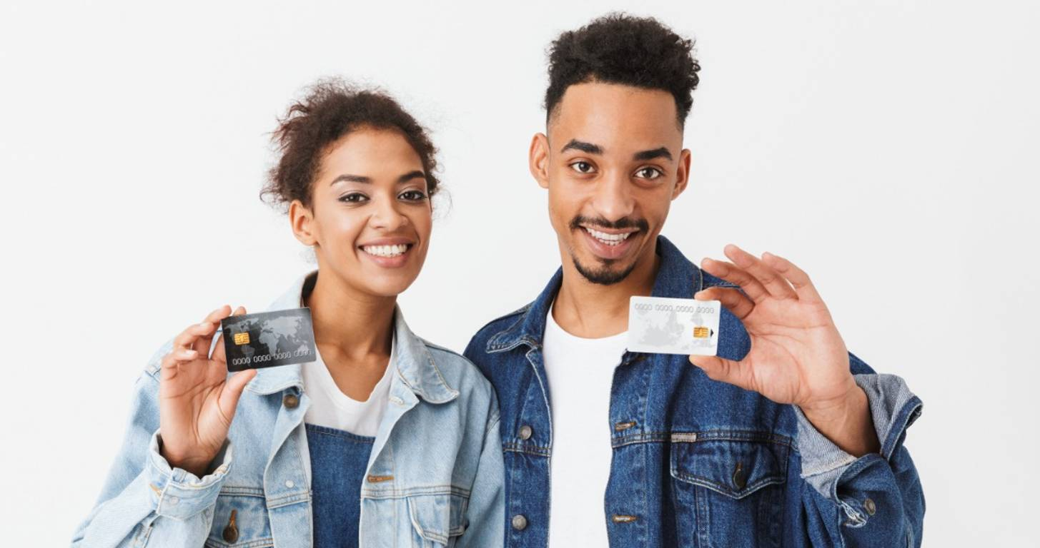 Young couple comparing American Express Gold and Platinum cards