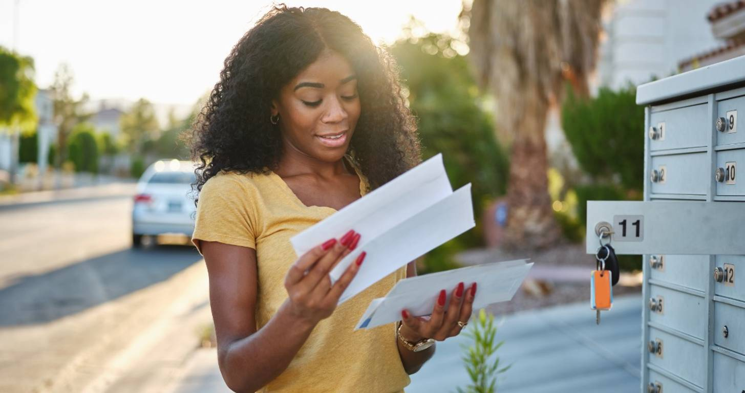 Woman checking her mail for prequalification offers